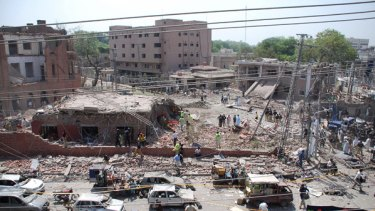 The destroyed police emergency response office building following a suicide car bomb attack in Lahore.