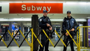 Police stand guard inside the Port Authority Terminal following.