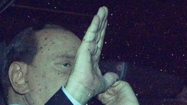 Waving goodbye to his job ...  Italian Prime Minister Silvio Berlusoni