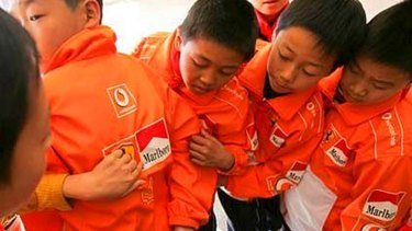 A message from their sponsor … students in KunMing Province, whose uniforms are covered in Marlboro advertisements.