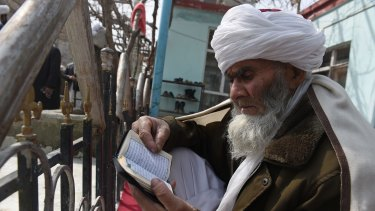 A Muslim reads the Koran at a mosque in Kabul this month.