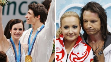 Gold medallists, Tessa Virtue and Scott Moir of Canada, on the podium, while Russian favourites Oksana Domnina and Maxim Shabalin ponder their bronze.