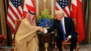 U.S. President Donald Trump, right, holds a bilateral meeting with Bahrain's King Hamad bin Isa Al Khalifa on Sunday.