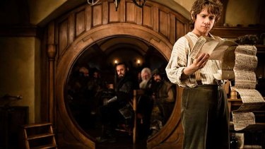 Man on a mission ... Martin Freeman as Bilbo Baggins surveys his quest and readies himself to pursue a fearsome dragon in the coming film version of <em>The Hobbit</em>.