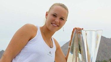 Caroline Wozniacki of Denmark poses with the trophy.