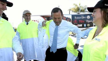 Opposition Leader Tony Abbott during his visit to a beef processing plant in Queensland yesterday.