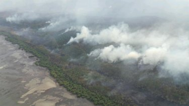 The bushfire burning on North Stradbroke Island on Monday morning. Photo: Penny Dahl/Australian Traffic Network, via Twitter.