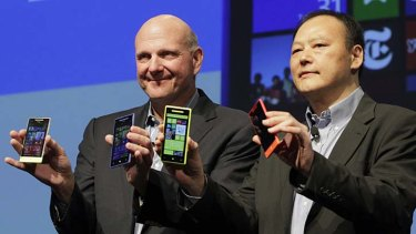 """Milestone"" ... Microsoft CEO Steve Ballmer, left, and HTC CEO Peter Chou show off the new HTC Windows 8 phones."