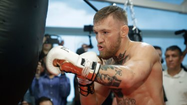 Born fighter: Conor McGregor trains in an open session ahead of his mega bout with Floyd Mayweather.
