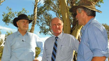 Picture this ... Tim Wright, right, tells Ross Garnaut and Tony Windsor about carbon storage on his property.