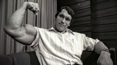 Arnold Schwarzenegger, who visited Sydney in 1974 as the reigning Mr Universe, flexes his muscles.