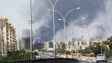 Smoke rises from the direction of Tripoli airport.