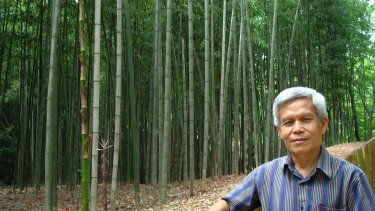 In this 2008 photo provided by his wife Shui Meng Ng, Sombath Somphone poses in an unknown location in Japan.