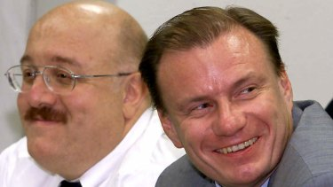Vladimir Potanin, pictured on the right in this photo taken in 2000, is one of Russia's richest men.
