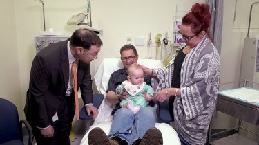 Professor John Rasko with Mark Lee, his partner and his daughter, who is a carrier for haemophilia B.