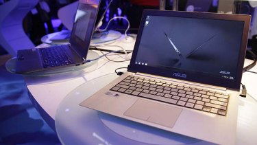Ultrabooks at the 2012 CES tradeshow . . . great if you can stop running your hands across the cool, polished metal.