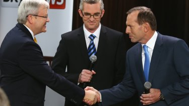 Kevin Rudd and Tony Abbott face off at the leaders' forum at the Broncos Leagues Club earlier this week.