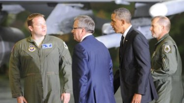 US President Barack Obama and Polish President Bronislaw Komorowski, second left, accompanied by US Air Force pilots walk for a meeting with soldiers at the military airport in Warsaw.