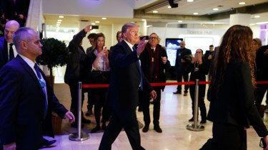 President Donald Trump waves as he walks to a dinner with European business leaders at the World Economic Forum in Davos on Thursday.