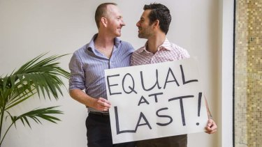 Nathan Thomas and Maikol Nobrega from Sydney at the ACT Legislative Assembly after the same-sex bill was passed. Photo: Rohan Thomson/The Canberra Times