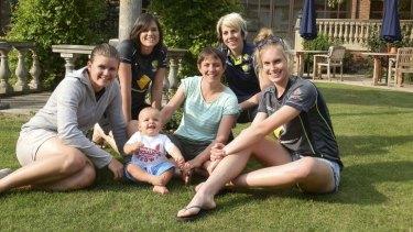 Holding the baby: Australia's Ashes stars enjoy some sun. From left, Jess Jonassen, Gemma Triscari, Sam and Sarah Elliott, Elyse Villani and Holly Ferling.