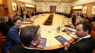 Prime Minister Tony Abbott meets with his ministry in the cabinet room at Parliament House in Canberra on Wednesday.