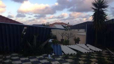Monday morning's storm left a fence down at this house in  Perth's northern suburbs.