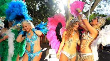 Participants prepare to put on a colourful show for the 2015 Mardi Gras at Hyde Park in Sydney.
