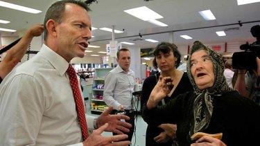 Tony Abbott (left) speaks to constituents.