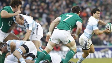 Argentina's Vergallo Nicolas, right, clears the ball from the ruck.