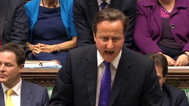 Heated ... Britain's Prime Minister David Cameron addresses parliament over the phone hacking scandal.