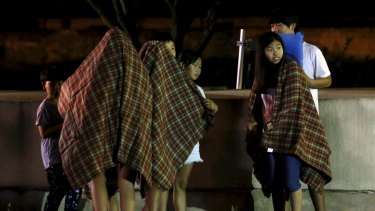 Children are covered with blankets as they are evacuated in front of a shelter near the demilitarised zone separating the two Koreas in Yeoncheon, South Korea, on Thursday.