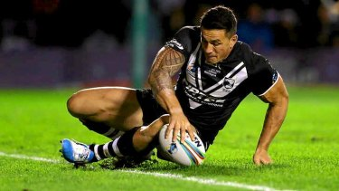 Oops: Kiwis superstar Sonny Bill Williams shows he is human, slipping over the deadball line against Samoa.