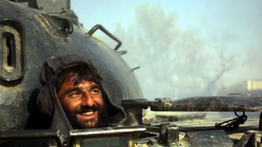 Endless conflict ... a Northern Alliance tank driver in Kabul in 2001.