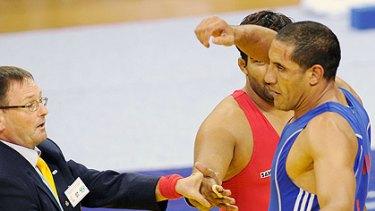 Fkiri refuses to shake hands with Anil Kumar.