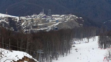 A view from near the alpine course showing the difference between the snow covered piste and the snowless lower slopes at Sochi.