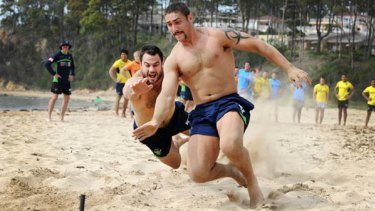 Photo finish ... Tom Learoyd-Lahrs beats David Shillington in a beach flags contest yesterday. Canberra were at Batemans Bay for a pre-season camp.