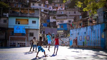 Football in the favelas. Photos: Buda Mendes/Getty Images.