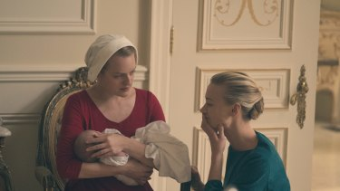 Offred the handmaid, played by Elizabeth Moss, and commander's wife Serena Joy, played by Yvonne Strahovski. Women in the fictional republic of Gilead have to play one of a limited number of proscribed roles.