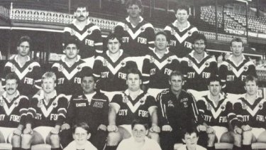 Former rugby league player John Tobin (middle row, third from right) was one of the men arrested.