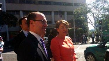 Premier Anna Bligh walks Treasurer Andrew Fraser to Parliament House.