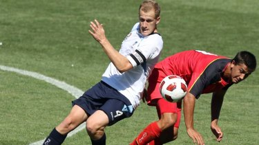 Showing faith . . . Sydney FC signs young star Nathan Sherlock, left..