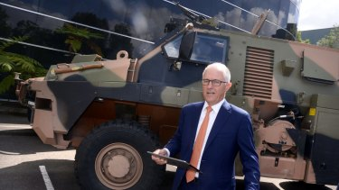 Prime Minister Malcolm Turnbull is pictured with a Bushmaster armoured vehicle at Thales Defence Exports in Sydney on Monday.