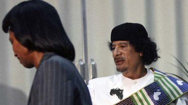 """Weird obsession"" ... Libyan leader Muammar Gaddafi, right, receives US Secretary of State Condoleezza Rice in Tripoli in 2008."