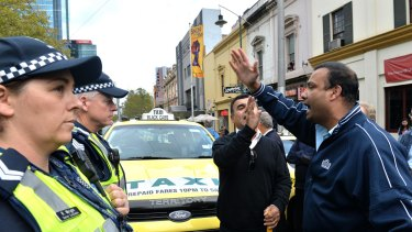 Taxi drivers and owners protest by blocking Bourke street