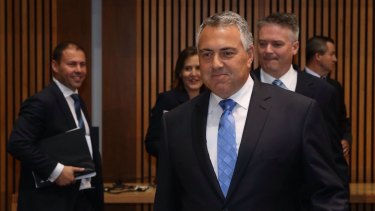 Tax cuts off the table: Treasurer Joe Hockey, with his frontbench team, at the release of the 2015 Intergenerational Report.