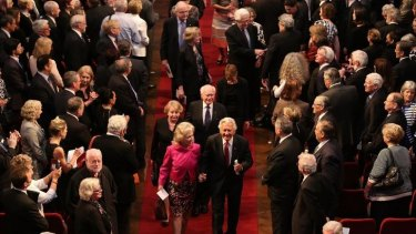 Former Australian prime ministers John Howard (back right) and Bob Hawke (front right) leave at the end of Gough Whitlam's memorial service.