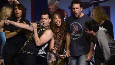 Performers, including Jordan Knight of New Kids on the Block (centre left), Steven Tyler of Aerosmith (centre) and comedian Dane Cook (centre right), perform during the Boston Marathon bombings benefit concert.