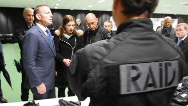 Australian prime minister Tony Abbott visiting RAID's offices in France.