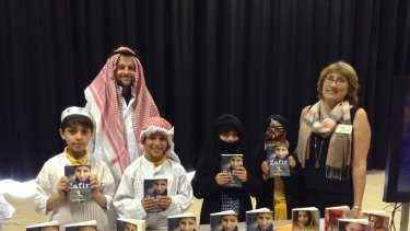 New understanding: Prue Mason, author of Zafir, with teachers and students at Serpell Primary school's Middle Eastern day.